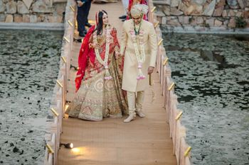 Bride and groom walking hand in hand.