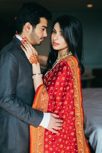 Photo of Romantic couple shot with bride wearing red dupatta
