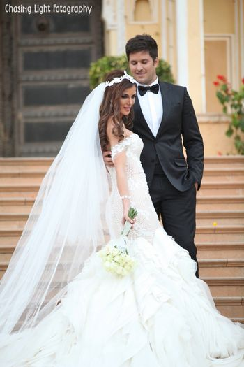 Christian Bride in White Ruffled Wedding Gown