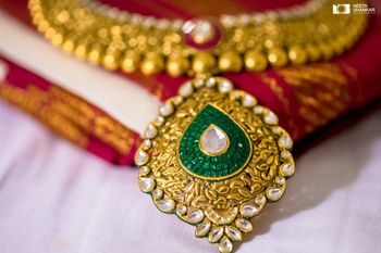 Photo of South Indian bridal necklace with emeralds