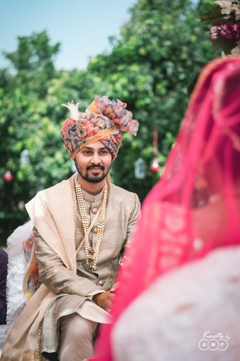 Groom in grey sherwani with contrasting floral safa