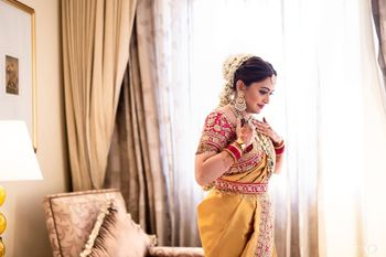 Fusion bridal look in yellow saree and floral jada