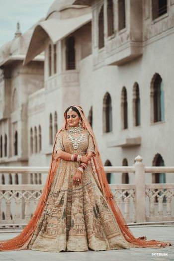 A bridal portrait with the bride in a royal lehenga