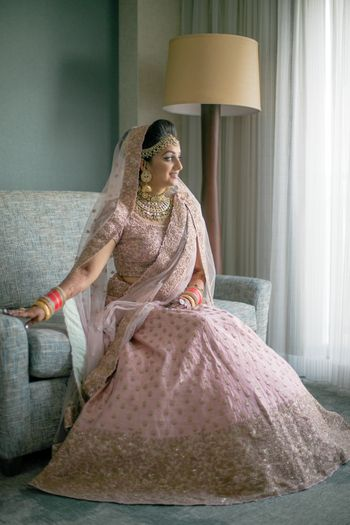 Photo of Blush pink and gold lehenga with broad border