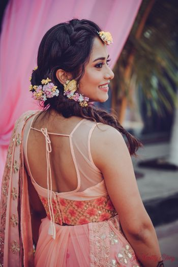 Mehendi look with floral braided hair
