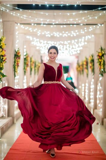 maroon gown for bride with a gold belt