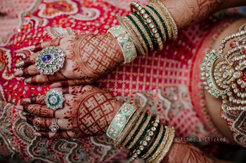 Photo of A shot of the bride's gorgeous rings and bangles on her wedding day