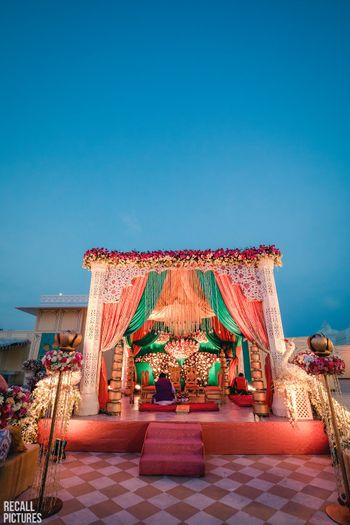 Photo of Unique floral mandap idea with drapes and florals