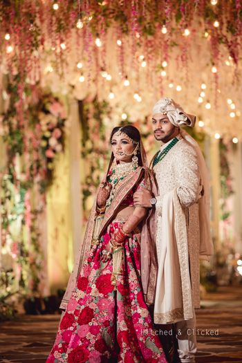 Photo of Sabyasachi bridal lehenga with contrasting groom