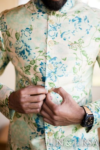 Off-white floral sherwani with blue and green flowers