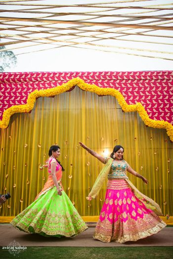 Photo of Neon colored lehengas