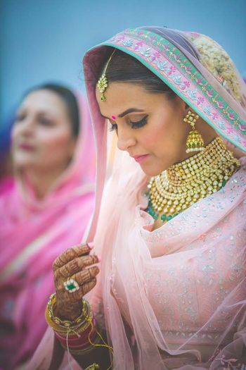 Neha Dhupa makes for a shy bride in light pink outfit at her anand karaj