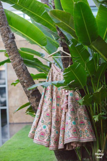 pastel pink sabyasachi lehenga on hanger
