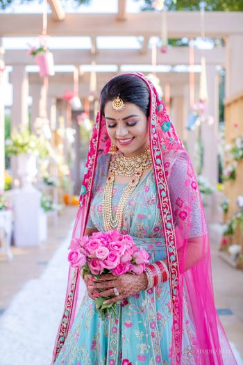 sikh bride in offbeat outfit holding a bouquet