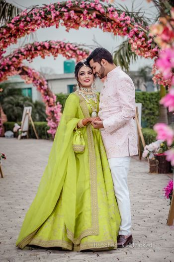 Photo of Mehendi couple shot with bride in light green lehenga