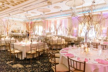 Photo of Unique table setting in light pink theme for reception