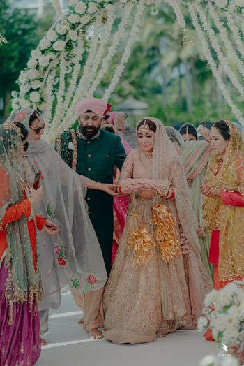 A bride entering for her Anand Karaj, along with her father