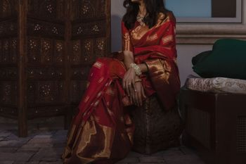 red and gold saree bride wore for the pooja