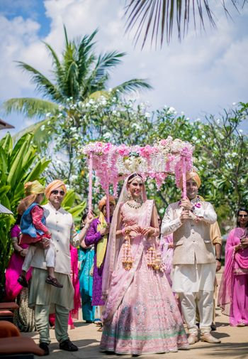 Photo of Bridal entry with a gorgeous pink and white phoolon ki chaadar