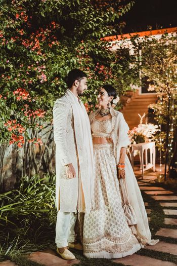 Photo of bride in a simple ivory lehenga for her intimate wedding