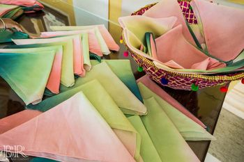 Photo of Pocket squares in pastel colours as favours