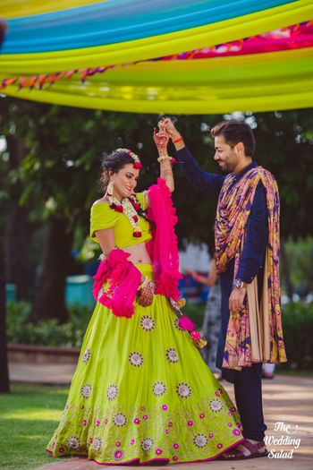 Light green and pink bright lehenga with ruffled dupatta