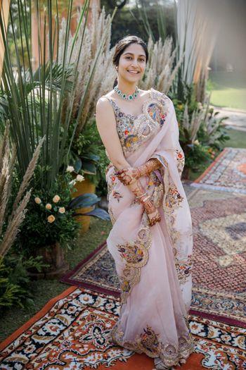 Bride wearing a pastel-hued organza saree.