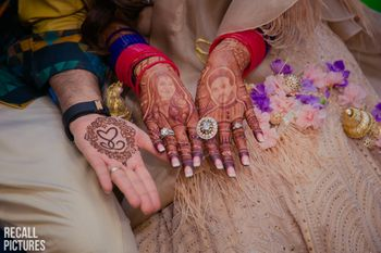 Cute parents caricatures as a bridal mehendi designs