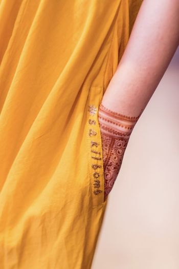 Bridal mehendi outfit with embroidered wedding hashtag