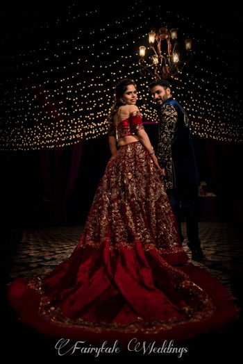 Photo of Maroon sangeet outfit with train