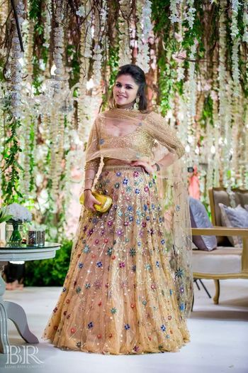 Photo of Pastel lehenga with floral print for sister of the bride