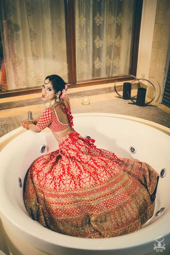 Photo of Bride in bath tub getting ready shot idea