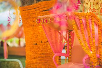Orange decor with bangles at mehendi