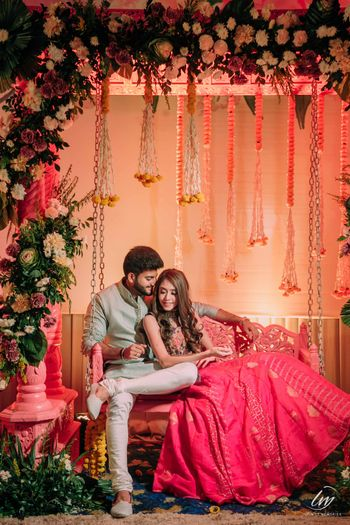 Photo of couple portrait on bridal mehendi seat