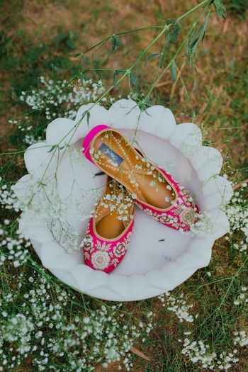 Pink bridal juttis with floral embroidery