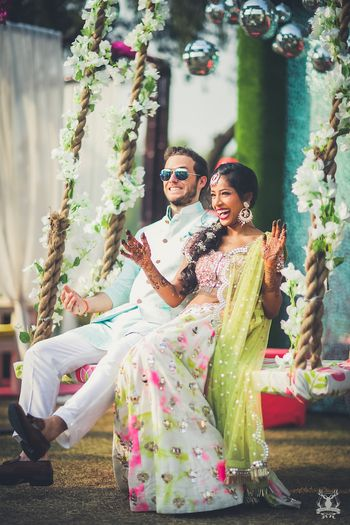 Photo of Cute couple portrait on mehendi swing