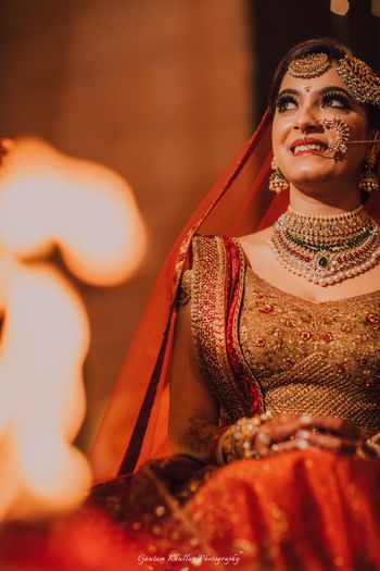 A bride in red lehenga with heavy jewellery