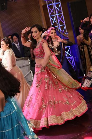 light pink net lehenga flared