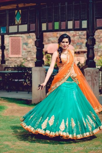 Photo of turquoise and orange mehendi lehenga