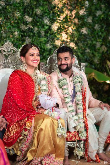 Happy couple wearing unique babys breath jaimala