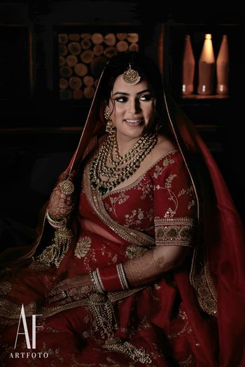 Photo of Bride wearing red sabyasachi lehenga with zardozi work
