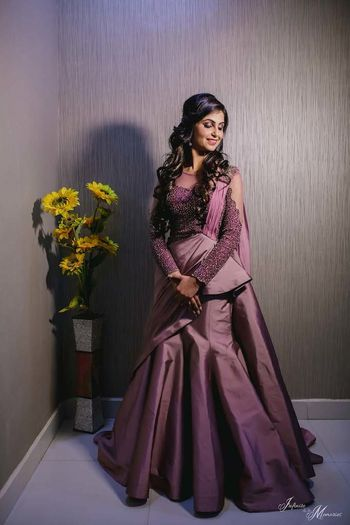 A bride in a lilac gown.