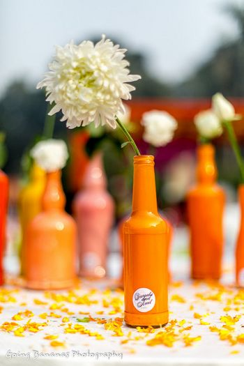Photo of handpainted bottles as table centerpieces