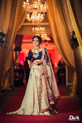 Photo of Blue and Off White Lehenga with Red Embroidery