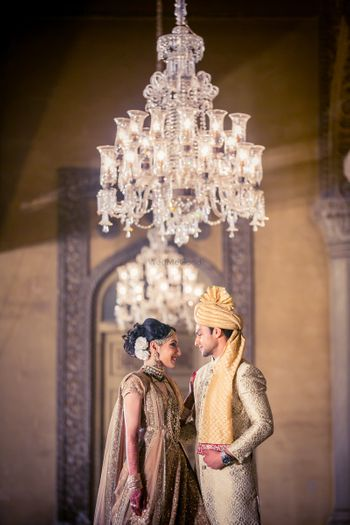 Photo of Couple in gold bridal outfits