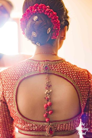 Bridal back with bun and keyhole style blouse