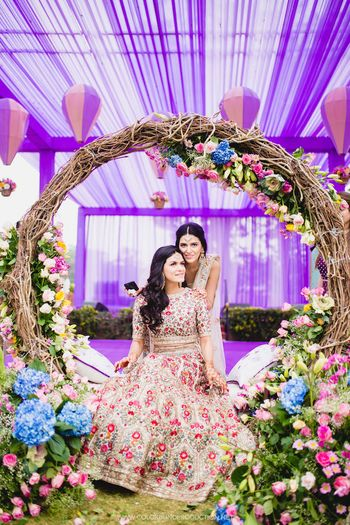 Photo of Bride with sister with gorgeous mehendi decor