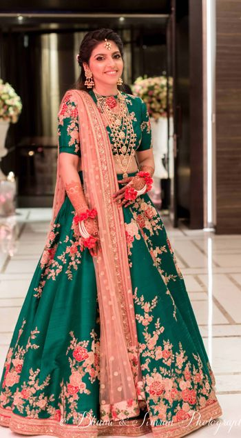 Photo of Green sabyasachi lehenga worn with 7 string necklace