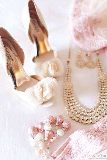Photo of Pastel blush pink bridal shoes with light pink lehenga