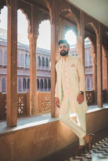 Mehendi groomwear kurta with jacket in pastel shades